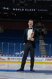 James Grant poses with the trophy at centre ice of the home of the Toronto Maple Leafs. It's nice, because that ice surface doesn't normally host trophy celebrations at centre ice.