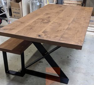 Fir planks from the Cloverdale Bridge have been used to make new items, like this table and attached bench.