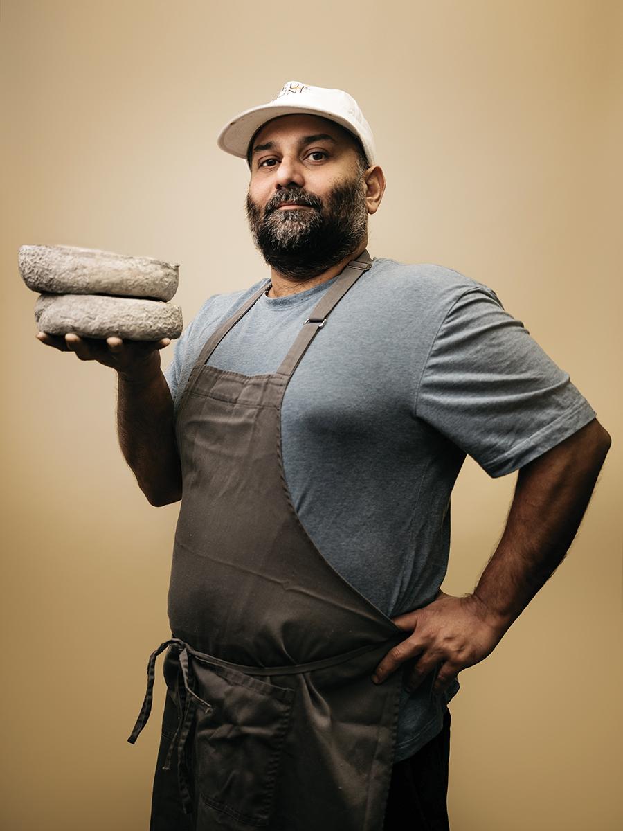 Aditya Raghavan, Chef and Owner of Fleur Jaune Cheese, holding a wheel