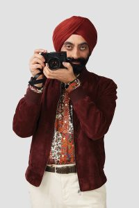 BD_GurmeetSingh_Standing_CameraUp_MaroonJacketAndTurban_PaisleyShirt_CreamPants