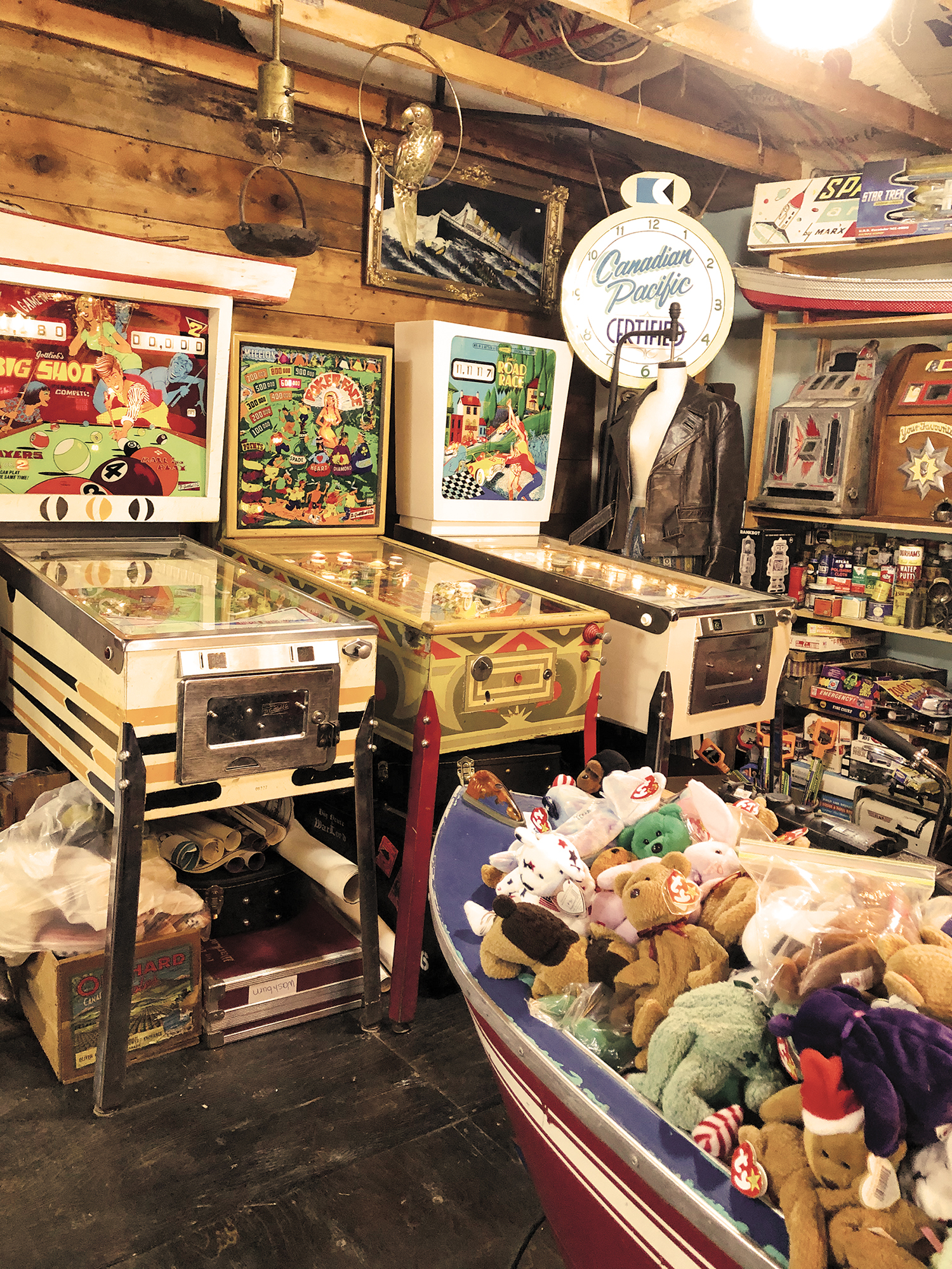 Antique pinball machines, stuffed beanie babies, Canadian Pacific clock, leather jacket.