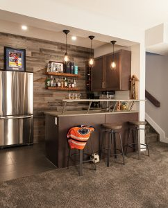 Stikwood on wall and shelves Urban Timber; concrete counter Urban Concrete; cabinets Huntwood; sink and faucet EMCO