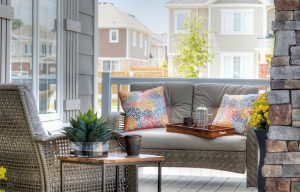 Front porch with sitting area overlooking the street.
