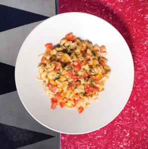 Classic Mac'n'Cheese topped with tomatoes. Photograph by Steven Babish.