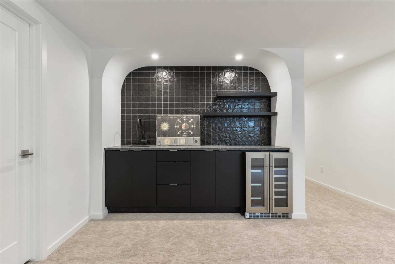 Basement wet bar with wine fridge