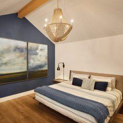 House2_Bedroom_Blue&White_AngledCeiling_LightWoodBeam
