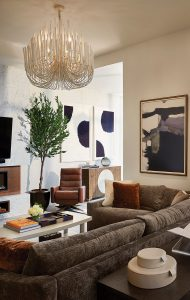 House5_LivingRoom_Chandelier_BrownCouch_WhiteWalls