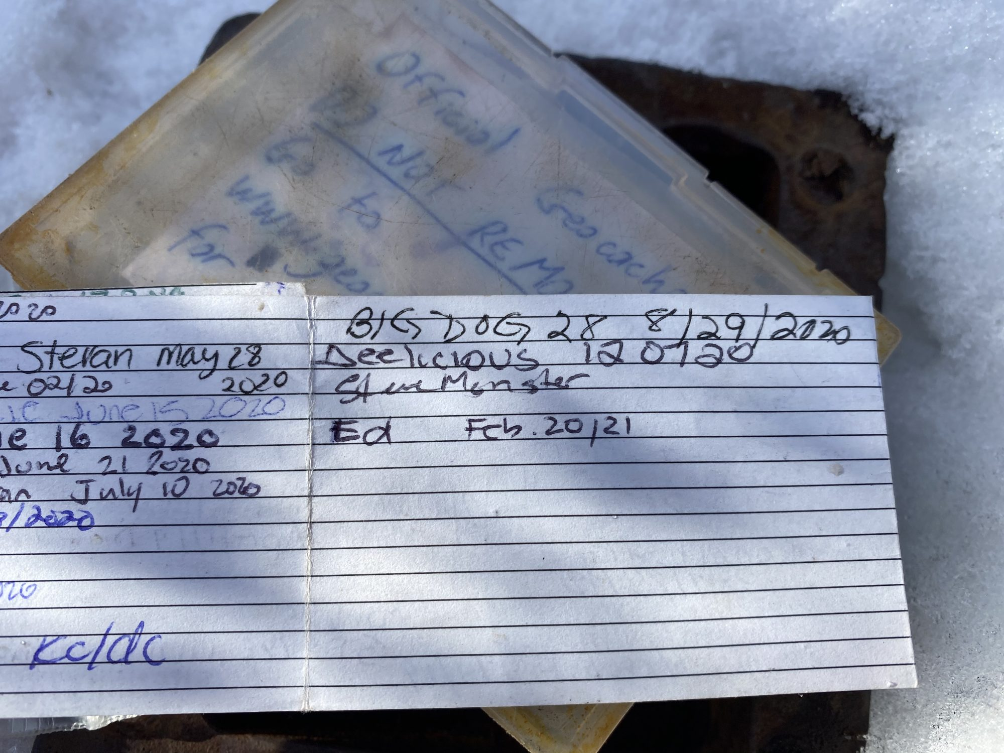 The contents of the imposter metal box with geocache log.