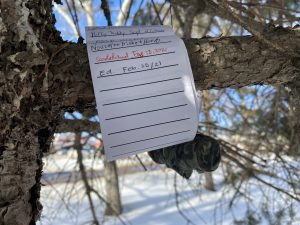 The unrolled geocache log, signed by Ed.