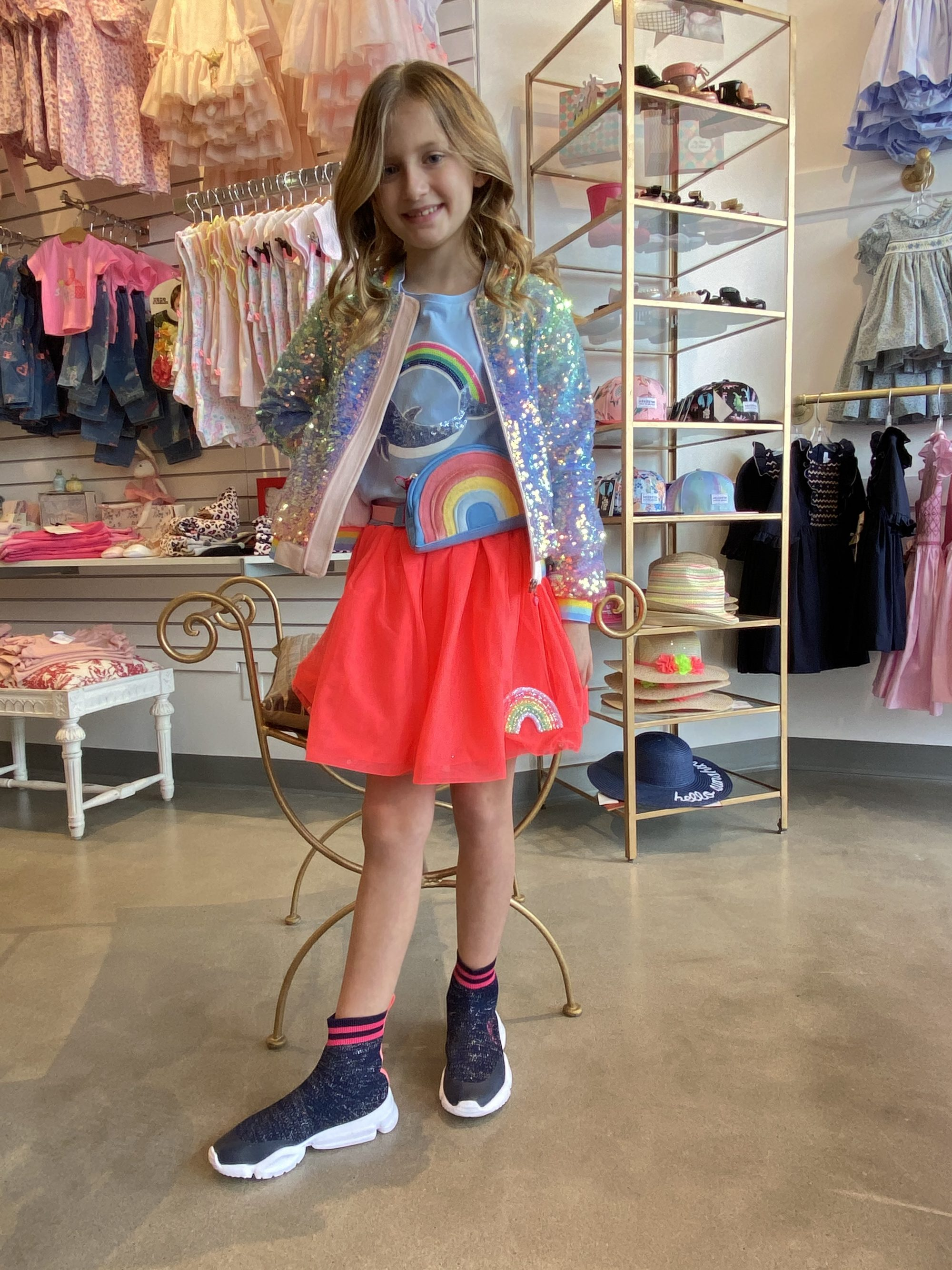 A girl wearing an outfit designed by Billieblush based in France