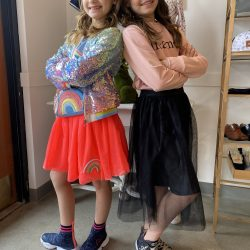 Two sisters posing in their outfits from Alligator Pie Kidswear in Edmonton
