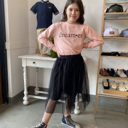 A girl wearing an outfit designed in Lloydminster, Canada