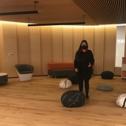 Emily Riddle, EPL senior advisor for Indigenous relations, stands inside Thunderbird House, at the Stanley A, Milner Library, Edmonton.