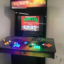 Vintage Teenage Mutant Ninja Turtles games at the GamerSpace at the Stanley A, Milner Library, Edmonton,