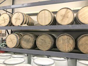 Whiskey barrels at White Lightning Distillery