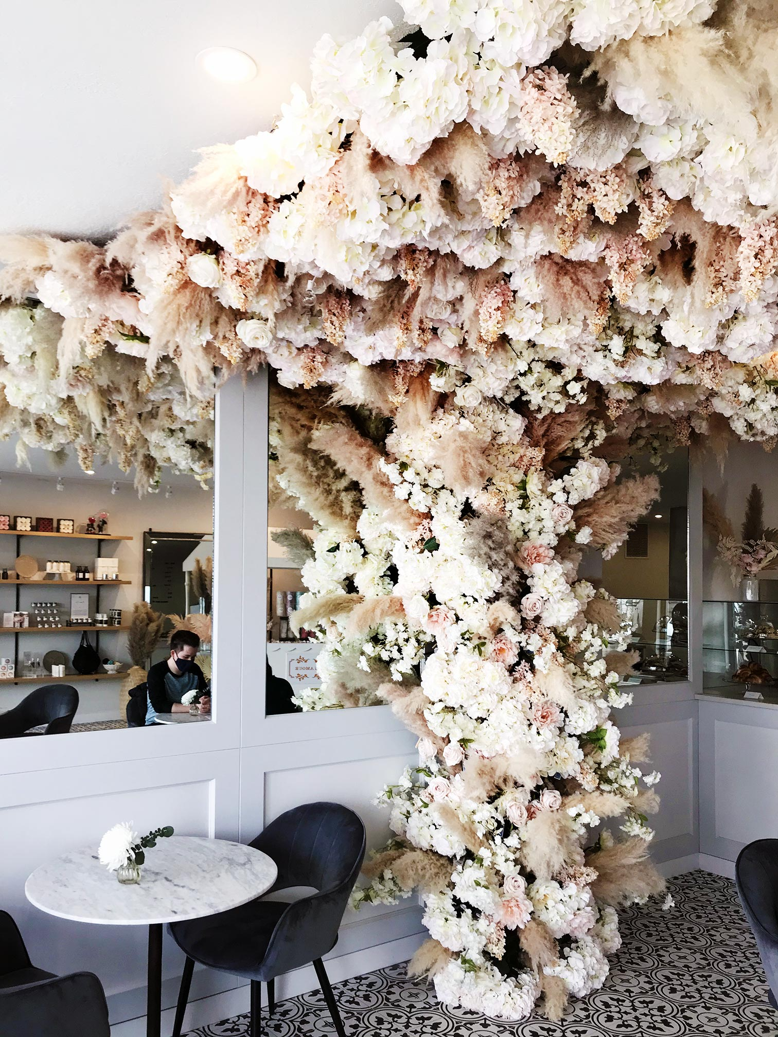 Faux flowers scaling the wall and ceiling