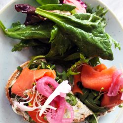 Salmon open-faced sandwich with beets, spinach, sprouts, tomato and endive