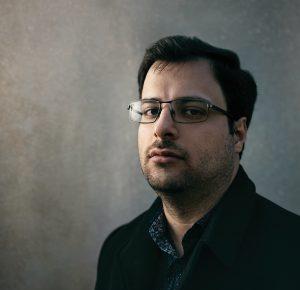 Javad Soleimani Meimandi, glasses, blac coat.