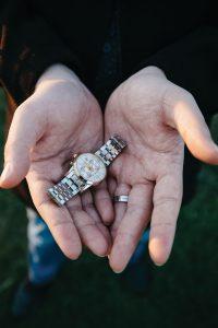 Javad Soleimani Meimandi's hands holding his late wife's watch.