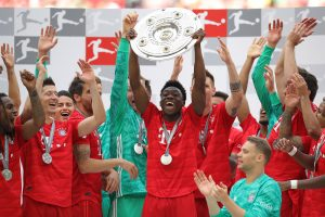Alphonso Davies and his Bayern Munich teammates celebrate the Bundesliga title.