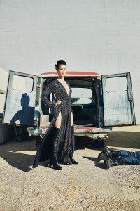Olivia Cheng in front of van