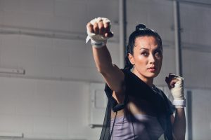 Olivia Cheng throwing a punch