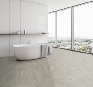Panoramic white tile bathroom corner with tub