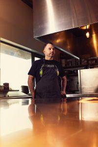 Paul Shufelt behind counter