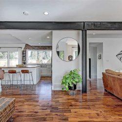 Wood floors, white walls and black metal beams