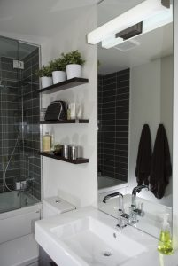 Planters from IKEA; floating shelves from Rona;  Metro Ceramic shower tiles from Julian Tile Edmonton; Laufen Pro dual flush toilet  and  Duravit sink from Cantu Bathrooms and Hardware; Grohe faucet from Allure