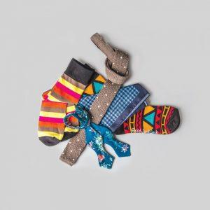 Ermenegildo Zegna tie, $185, and Hugo Boss pocket square, $65, from Henry Singer; socks from Good Luck Sock, $12, from Kunitz Shoes; Offal Goods bow tie, $60, from Barber Ha.