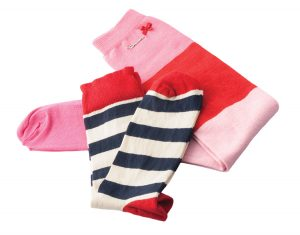 Pink and red knee high socks by Avoca, $35, and blue, white and red unisex socks by Happy Socks, $15, from Red Ribbon. (12505102 Ave., 780-454-4336)