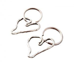 Silver heart-shaped hoop earrings by Karyn Chopik, $85, from The Tin Box.