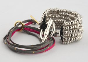 Gorjana's triple-strand bracele tmade with leather and gold-plated studs, $98, from Shades of Grey Boutique (10116 124 St., 780-756-5199). Chunky Chanii B silver bracelet, $130, from Katwalk Shoes.